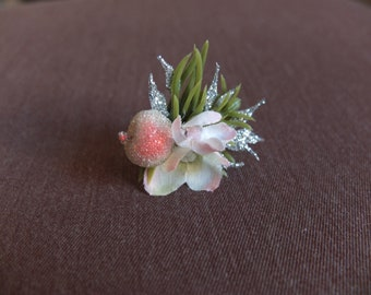 Romantic flower ring with a frozen apple