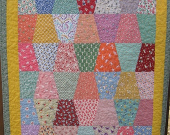 Free shipping in the U.S. for this 1930's Reproduction TumblerBlock Baby Quilt