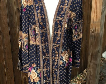 Vintage 1960s-70s Lady Carol of New York jacket. 100% rayon. Mixed print floral, geo, paisley. Hipster kitschy. Shoulder pads. Made in USA!