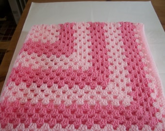 Hand crocheted baby blanket. Pale and mid pink. Suitable for car seat, crib, pram or moses basket. Ideal just to wrap baby in.