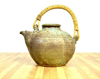 Signed Rustic Teapot Earth Tones Rattan Wooden Handle Unique Pouring Spout Flat Top Lid Air Release Hole