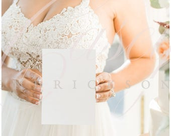 Blank 5x7 mockup stock photo of bride holding invitation paper