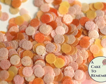 Orange edible confetti for cake decorating, cupcake decorating and cake pop decorating. Biodegradable confetti cupcake sprinkles