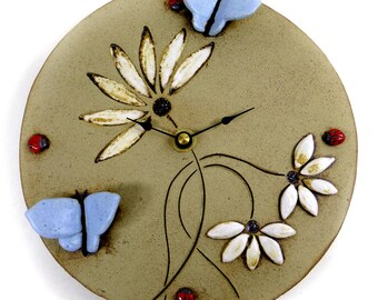 Pale Blue Butterfly Clock with Daisies  and Ladybirds by Maggie Betley Zoo Ceramics - Slab Built + Hand Carved British Design