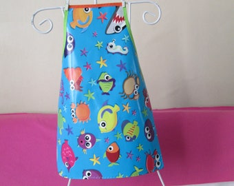 Child's oilcloth apron: 6/8 years old ocean