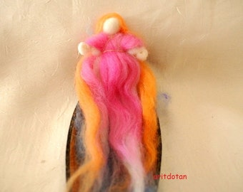 Wool fairy sleeping in a dried fruit pod made in method of needle felted soft sculpture, Waldorf education