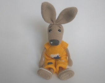 Bunny in a yellow jumpsuit. Crocheted.