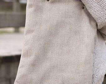 Tote style bag in cream tone.