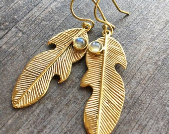 Long brass leaf like earrings with a small Labradorite stone