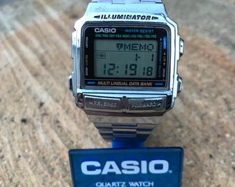 Casio DB-590 Mod1252 Data Bank Rare Vintage Multi Lingual Good condition new battery ILLUMINATOR WR Alarm stainless steel strap original