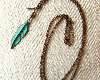 Bronzed chain with teal feather accent
