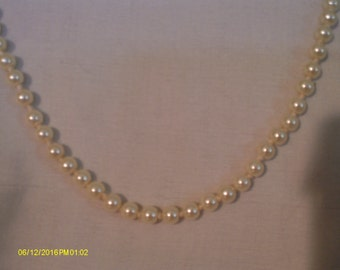 White hand knotted glass pearls