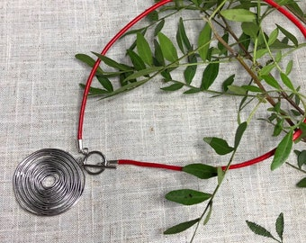 Swirly silver pendant and genuine leather necklace