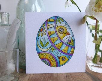 Blue Easter Egg greetings card. Folk art style with chicks, foliage and celestial designs.
