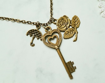 Vintage Style Bronze Tone Necklace with Pendant Key with Flower and Umbrella