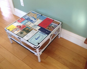 Side table with vintage travel collage