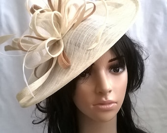 Creamy Ivory Fascinator with Gold trim & feathers on a Headband..