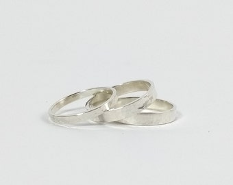 Silver band ring. Hammered. 3 mm wide. 2 Sizes available 52 - US 6 - ES 12 and Small 54 - 6 3/4 - 10 1/2