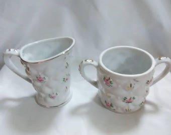 Vintage pink floral creamer and sugar bowl. Ceramic.