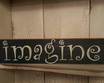 Imagine stenciled sign with rusty star