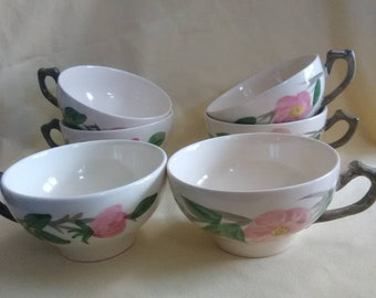 Vintage tea cups. Cream with pink roses. Handle looks like a branch. Made in England. All are numbered.