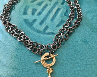 Long chain necklace with 14kt gold clasp and Baroque pearl