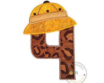 Safari birthday number four (4) in brown animal print and yellow speckled pith helmet sporting dark brown detailed embroidery and khaki band