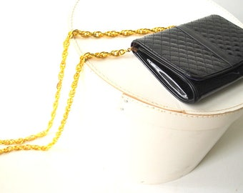 glamour vintage 80s black, shiny patent leather, small, qualted purse-clutch with extra large , chunky chain hadle. Made by Glam Rock.