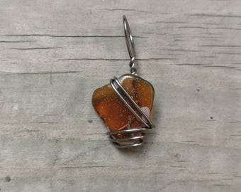 Brown sea glass wire wrapped pendant from Glass Beach, CA