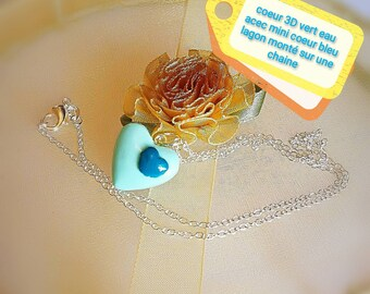 A beautiful watery green 3D heart and mini heart lagoon mounted on a silver plated chain