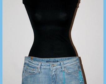 SABATLER: hand-stitched denim shorts.