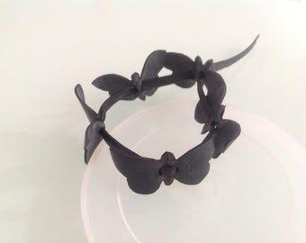 Butterflies in inner tube bracelet.