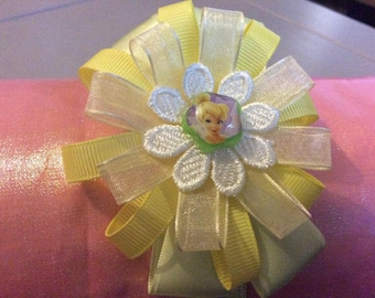 Green satin,yellow grosgrain ,organza flower headband with flower centre and fairy resin embellishment
