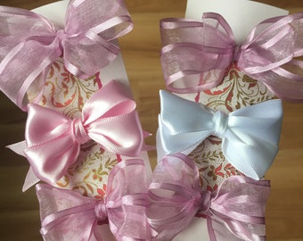 Sweet pink chiffon and satin bows