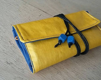 Tobacco pouch in yellow and blue laminated cotton fabric