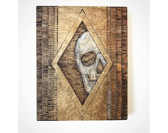 Geometric skull wood burning, Skulls and lines