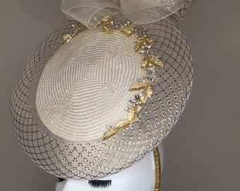 Ivory percher with gold embellishments.