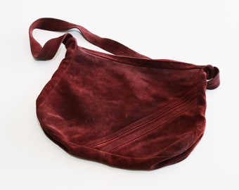 Vintage 1970s super soft and perfectly worn suede purse bag in maroon