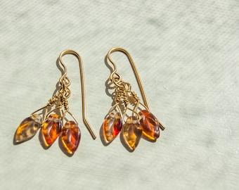 Glass leaf beads on 14k golf filled earings
