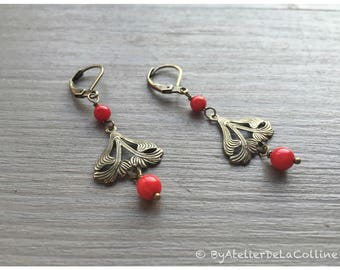 Art deco earrings and coral beads