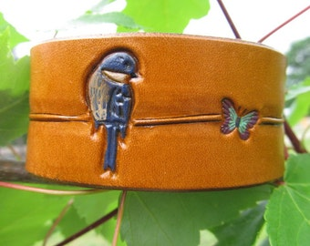 Hand Painted Toole Leather Bracelet Cuff - Blue Birds and Butterflies on a Wire or Branch - Brown Stain with Snap