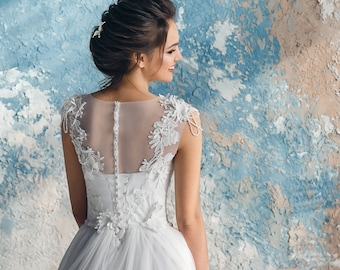 A-line tulle bridal gown,normal shoulder,3D voluminous lace,sweetheart neckline,lace top, shoulders with playful beads, 3D flower