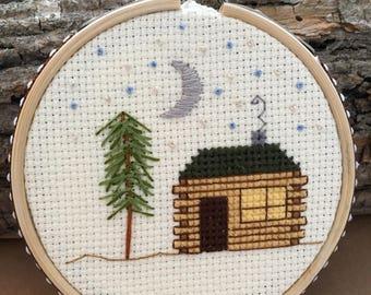 Log cabin night