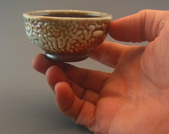 Gong Fu Cup, woodfired stoneware w/ crawling shino and natural ash glazes