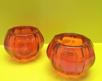 Vintage orange glass candleholders