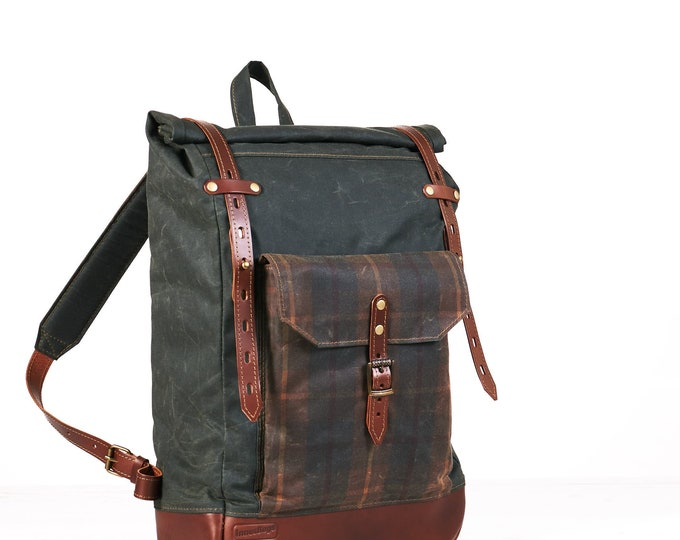 Green waxed canvas roll top backpack.