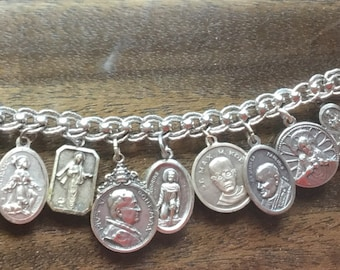 Heavy sterling silver bracelet with religious charms