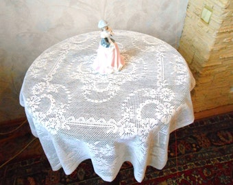 Cotton lace tablecloth Vintage white tablecloth of a tea table.  lace flower ornament. An ancient tablecloth of white lace.