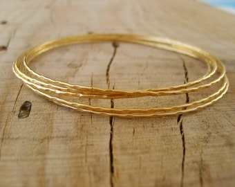 Hand crafted thin bangle bracelets in gold, gold bangle bracelets, set of 5