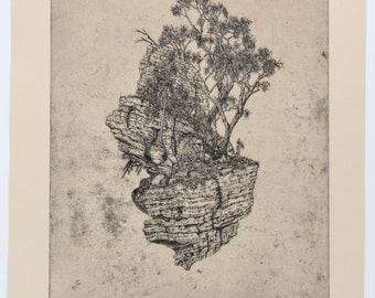 """Title: """"Birrarung Rock"""" Limited edition etching, intaglio print, on paper. Fantasy landscape with rock, trees, Australian reference."""